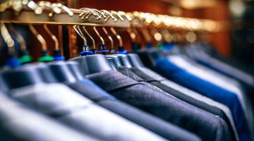 Suits on a rack in UK retail sector