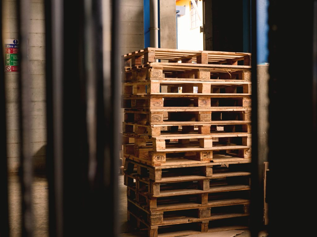 Pallets stacked by warehouse door